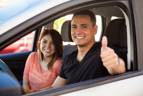 Smiling Man and Woman Sitting Inside Car