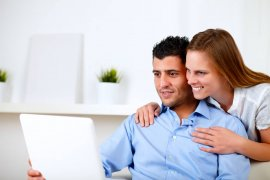 Picture of a Couple Using a Laptop Together at Home
