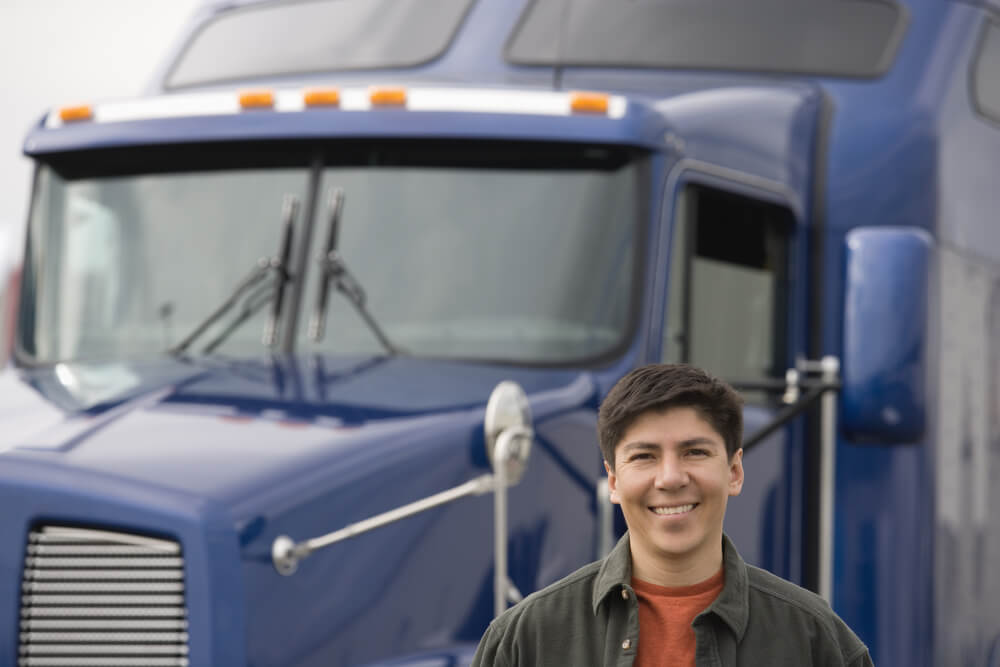 Hispanic Man Standing in Front of Commercial Truck