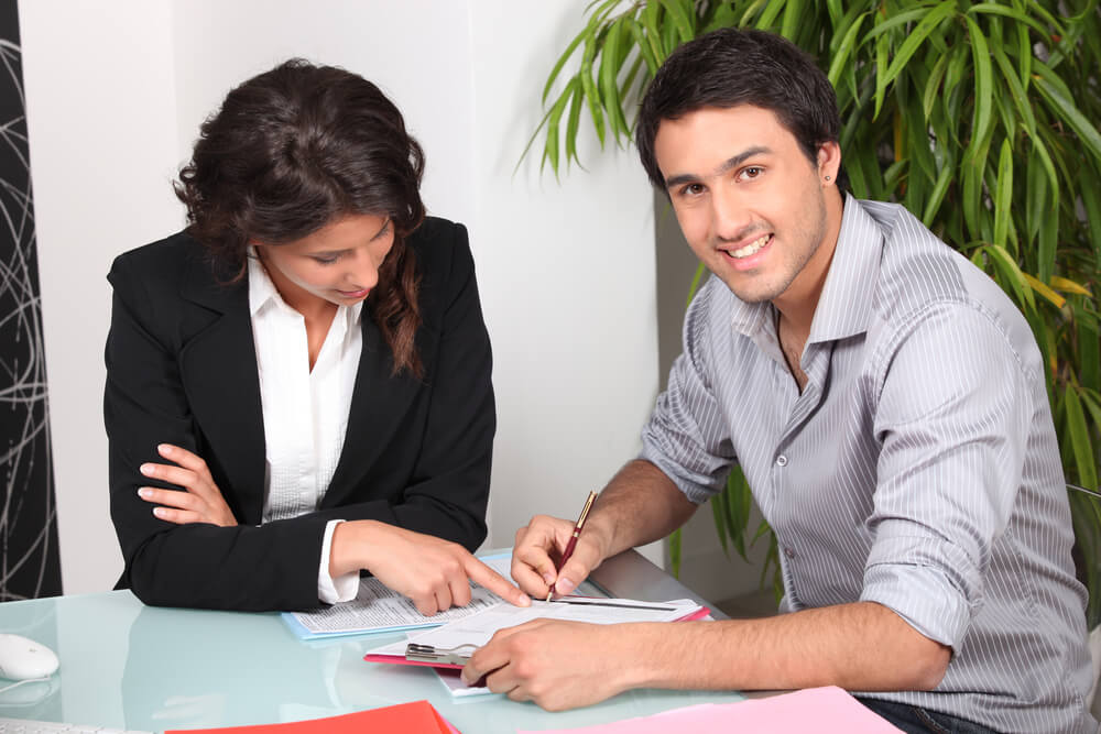 Portrait of a landlord and potential tenant filling out rental application