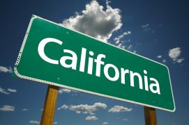 California road sign with sky and clouds in the background