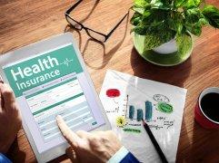 Female applying for health insurance online using an iPad