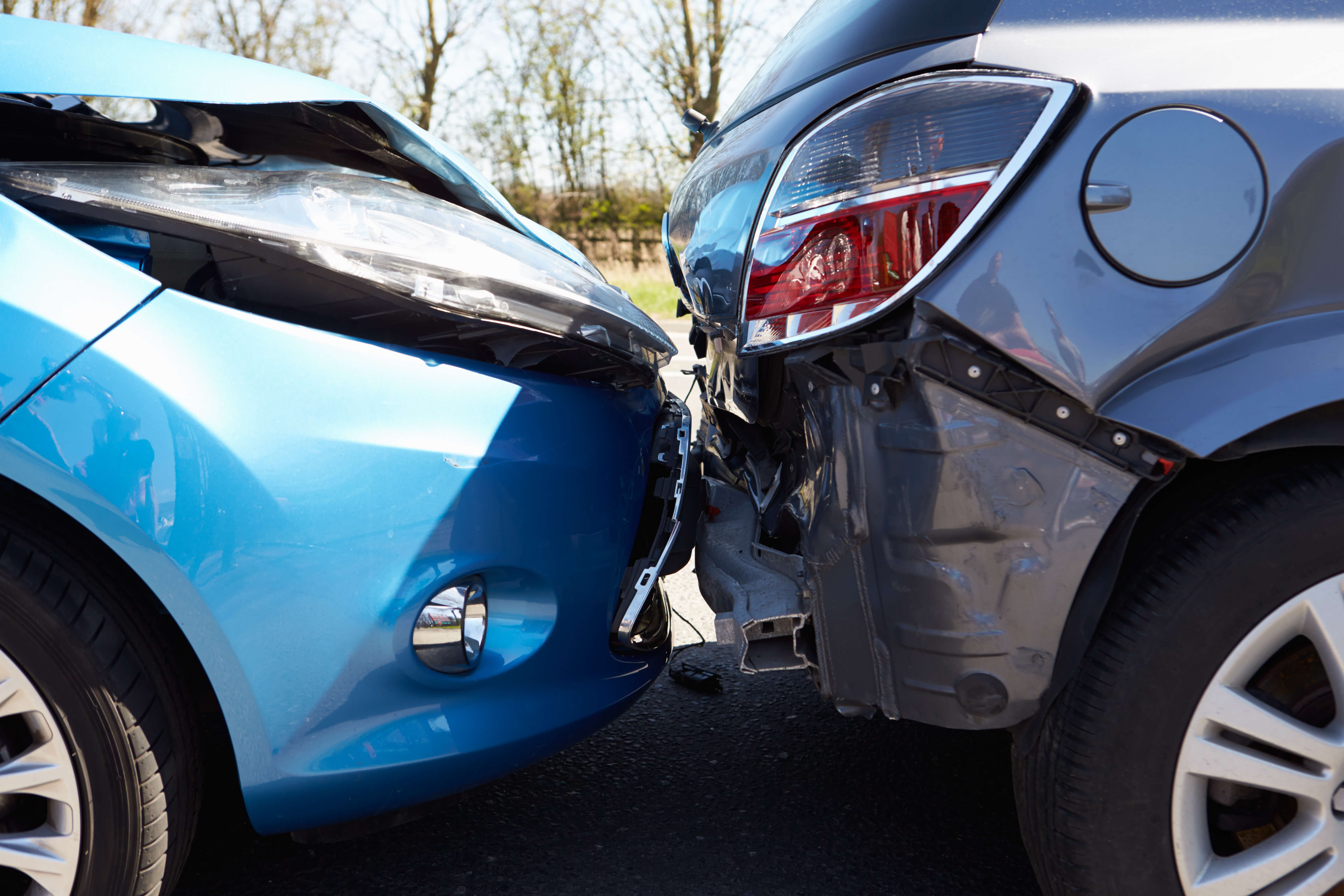 Close up of two cars involved in minor accident