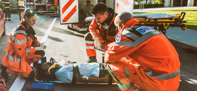 paramedics tending an accidental death with ADD insurance