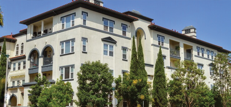 apartment complex building with tenants and renters insurance