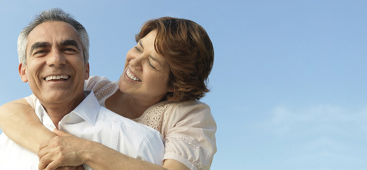 happy older couple hugging because they have life insurance