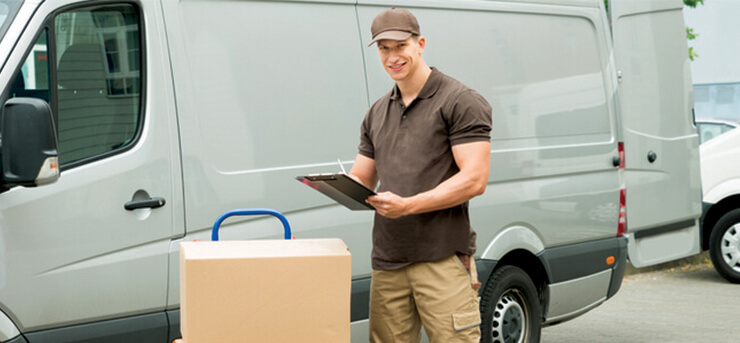 delivery man in front of van with boxes and commercial vehicle insurance