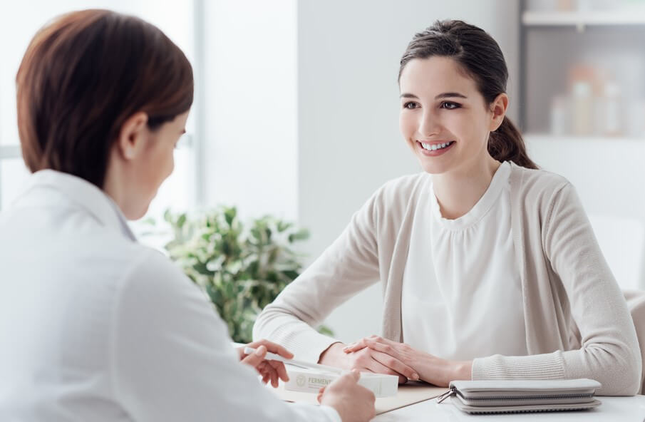 female doctor talking to patient during california open enrollment extension